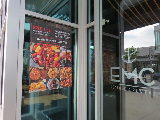 A poster at EMC Seafood & Raw Bar at The Collection at RiverPark in Oxnard alerts diners to a menu change that took effect June 5. The restaurant now features gumbo, po'boys and Louisiana-style seafood boils.