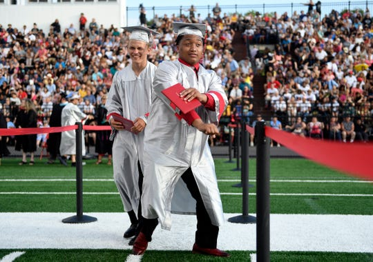 One of the 635 students that received a diploma during the 2019 Vineland High School graduation at Gittone Stadium on Wednesday, June 19.