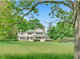 Glenn Close's 10.8-acre Beanfield estate on Succabone Road in Bedford features a 5,700-square-foot renovated farmhouse, a guest cottage, a barn/garage, a playhouse with sleeping loft, an outdoor pool, and more, according to the listing by Ginnel Real Estate.