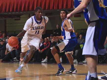 From left, Dobbs Ferry's Eric Paschall (11) drives around North Salem's Umar Singh (24) during the boys basketball Section 1 Class B semifinal game at the Westchester County Center in White Plains Feb. 27, 2013. Dobbs Ferry won the game 72-66.