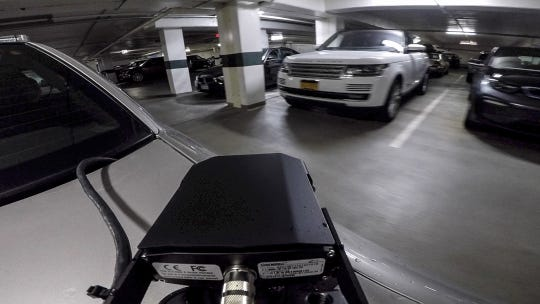 A Scarsdale parking enforcement car with a license plate reader makes its way through a parking garage to find parking violations.  Thursday, June 20, 2019.