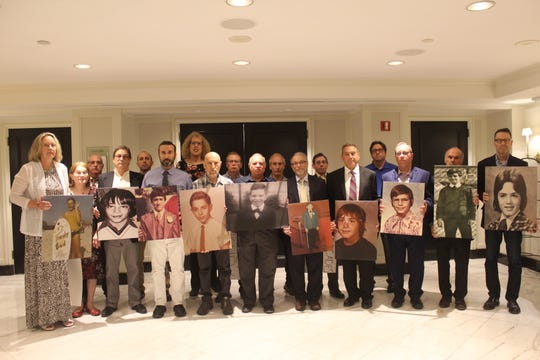 Archibald Survivors  hold pictures of themselves as children