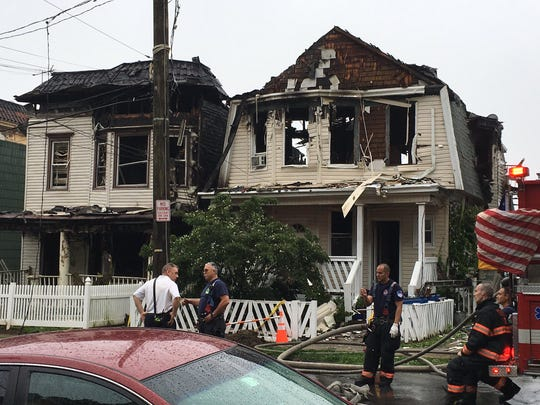 A two-alarm fire damaged four houses on Warburton Avenue on Wednesday night. Firefighters are on the scene on Thursday, June 20, 2019.