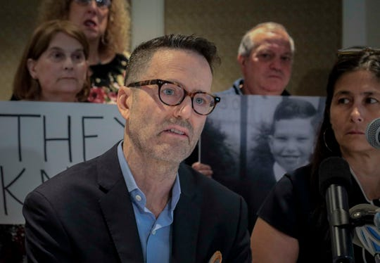 """Matthew Harris, a childhood sex abuse victims, discuss his abuse at a press conference, Thursday June 20, 2019, in New York. Over 200 survivors, including Harris, allege that for more than 40 years Reginald Archibald, a pediatric endocrinologist and researcher who worked for Rockefeller University, used his position to abuse children as young as 2 years old. """"I pray that those of us who were harmed are granted justice,"""" said Harris."""