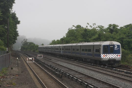 A Metro-North Railroad train heads toward New York City past the Greystone station in Yonkers on June 20, 2019, while two tracks are blocked because of a mudslide caused by a fire on Warburton Avenue overnight.