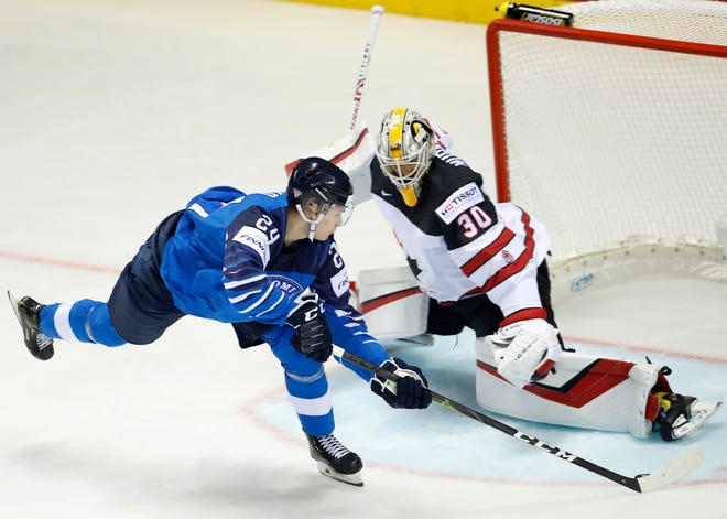 In this May 10, 2019, file photo, Finland's Kaapo Kakko, left, scores his sides first goal past Canada's goaltender Matt Murray during an Ice Hockey World Championships match in Kosice, Slovakia. The New Jersey Devils have a decision to make between selecting American center Jack Hughes and Finland forward Kaapo Kakko with the first pick in the NHL draft on Friday, June 21.