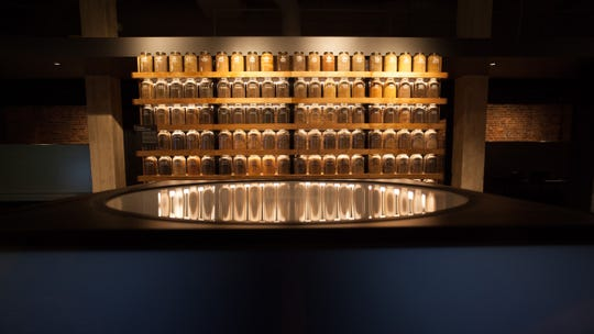 Jars of soil from lynching sites across America appear in an exhibit at the Legacy Museum in Montgomery, AL.