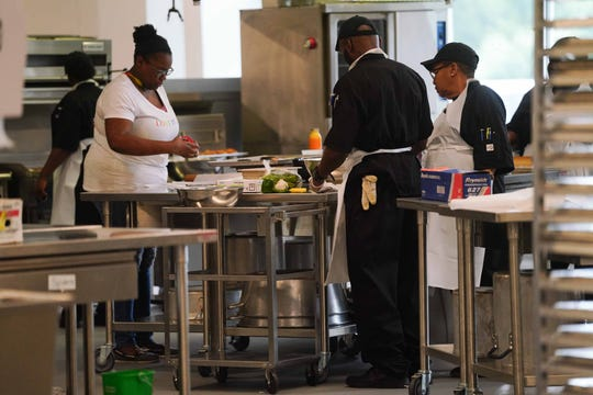 Students and instructors work in the new culinary arts school kitchens at the Food Bank of Delaware.