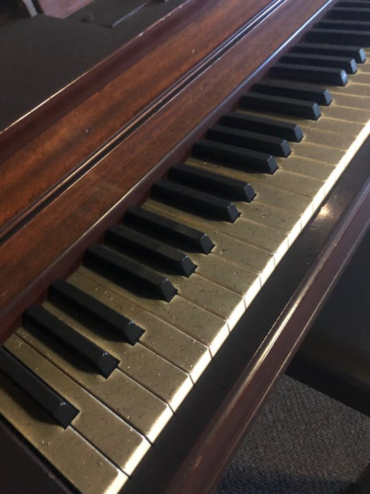 The piano in the sanctuary of the Episcopal Church of Wichita Falls was covered in soot after a recent fire.