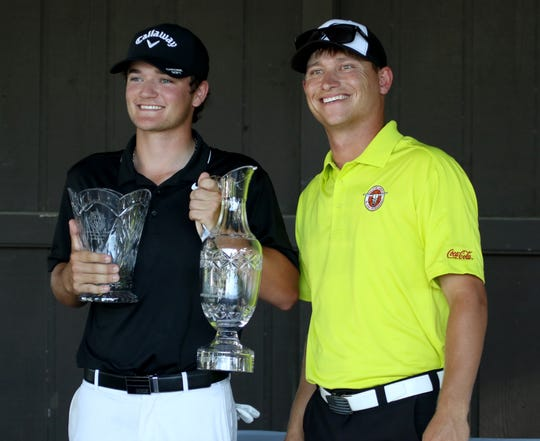 Isaiah Brevick, Argyle, TX, is presented with his trophies after winning the Boys Opwn Championship Wednesday, June 19, 2019, at the Texas-Oklahoma Jr. Golf Tournament at the Wichita Falls Country Club.