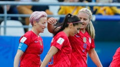 United States forward Alex Morgan (13) celebrates with teammates Lindsey Horan (9) and Megan Rapinoe (15) after scoring a goal against Thailand in group stage play.
