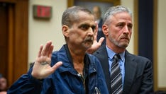 6/11/19 10:44:46 AM -- Washington, DC, U.S.A  -- Jon Stewart helps Luis Alvarez, Detective (Ret.) and 9/11 Responder, New York Police Department, as they are sworn before testimony in front of the House Judiciary Committee on the need to reauthorize the September 11th Victim Compensation Fund on June 11, 2019 in Washington.   --    Photo by Jack Gruber, USA TODAY Staff ORG XMIT:  JG 138068 Jon Stewart Cong 6/11 (Via OlyDrop)