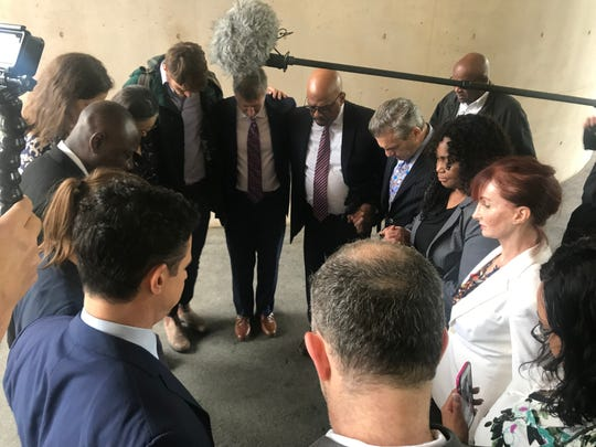 Descendants of the photographed slaves Renty and Delia , descendants of former Harvard professor Louis Agassiz and attorneys form a prayer circle prior to their announcement on June 20, 2019.