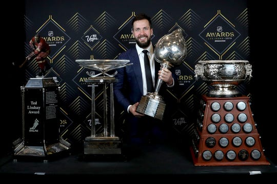 Tampa Bay Lightning star Nikita Kucherov poses with the Hart Trophy and the other awards he won this season.