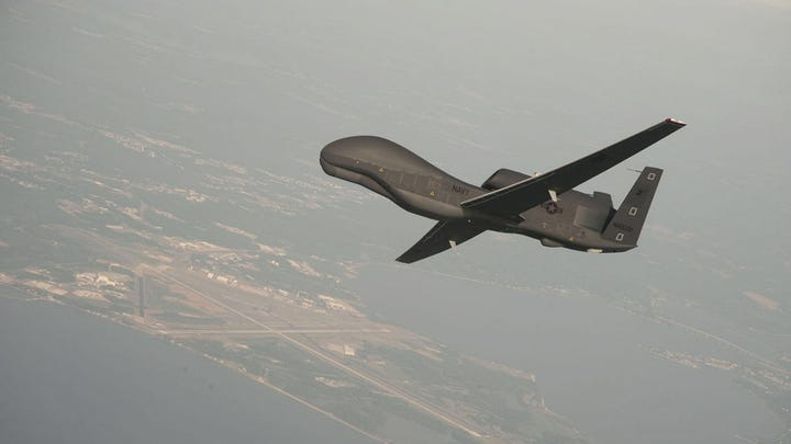 A handout photo made available by the US Navy provided by Northrop Grumman, a RQ-4 Global Hawk unmanned aerial vehicle conducts tests over Naval Air Station Patuxent River, Maryland, USA 25 June 2010. Media reports on 20 June 2019 state that Iran's Islamic Revolution Guards Corps (IRGC) claim to have shot down a US spy drone over Iranian airspace, near Kuhmobarak in Iran's southern Hormozgan province. The US military has not confirmed if a drone was hit.