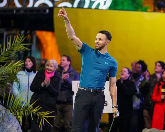 """NBA superstar Stephen Curry guides a shot on the new ABC miniature golf competition, """"Holey Moley."""" Curry, a scratch golfer, serves as executive producer and """"resident golf pro."""""""