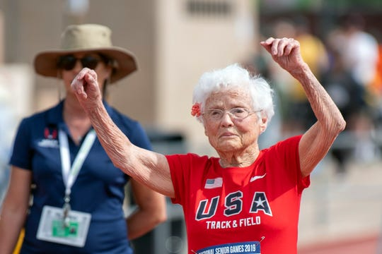 103-year-old Julia Hawkins, of Baton Rouge, La., celebrates after completing the 50-meter dash at the 2019 National Senior Games in Albuquerque, N.M.