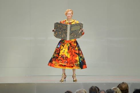 """At the Karl Lagerfeld Homage in Paris, Tilda Swinton read from,Virginia Woolf's """"Orlando,"""" one of the fashion designer's favorite works: """"Clothes wear us and not we them."""""""