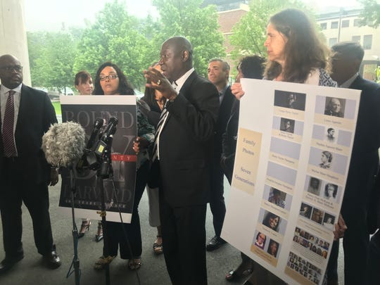 Civil rights attorney Benjamin Crump, one of the attorneys for Tamara Lanier, speaks alongside descendants of Harvard professor Louis Agassiz and descendants of Lanier's enslaved ancestors Renty and Delia on June 20, 2019.