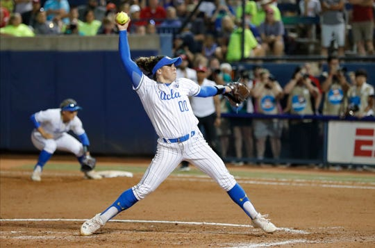 UCLA's Rachel Garcia pitches against Oklahoma in the fifth inning of Game 2 of the best-of-three championship series in the NCAA softball Women's College World Series in Oklahoma City, Tuesday, June 4, 2019. UCLA won 5-4, taking the series.