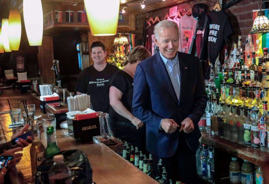 Former Vice President and 2020 Democratic presidential candidate Joe Biden, right, joins bartenders behind the counter during his visit to the Stonewall Inn, Tuesday, June 18, 2019, in New York. Biden paid a visit to the Stonewall Inn ahead of the 50th anniversary of an uprising that helped spark the gay rights movement.
