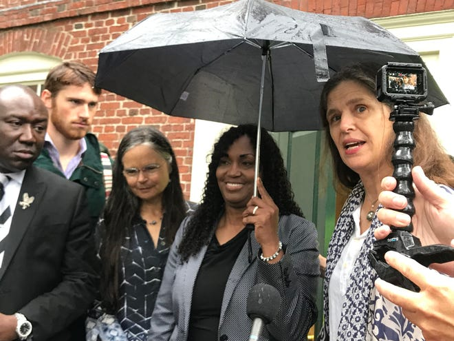Tamar Lanier, holding an umbrella, flanked by sisters Susanna McKean Moore and Marian Shaw Moore, descendants of former Harvard professor Louis Agassiz.