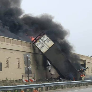 Semi-truck plunges 30 feet off highway turning into a fatal fire ball