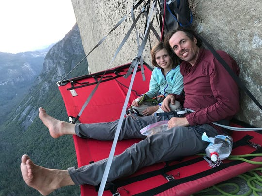 In this June 11, 2019, photo, is Michael Schneiter posing with his daughter, Selah Schneiter, during her climb up El Capitan in Yosemite National Park, Calif.