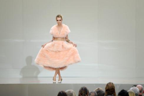 Cara Delevingne speaks at the Karl Lagerfeld Homage at Grand Palais on June 20 in Paris.