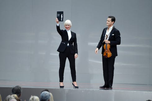 Helen Mirren read from Karl Lagerfeld's memoir, accompanied by violinist Charlie Siem, during the Karl Lagerfeld Homage at Grand Palais in Paris.