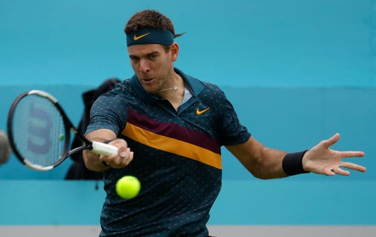 Juan Martin Del Potro of Argentina plays a return to Denis Shapovalov of Canada during the Queens Club tennis tournament.