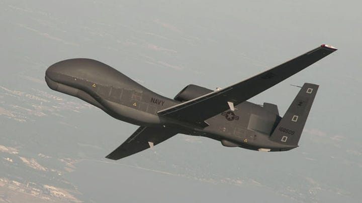 A handout photo made available by the US Navy provided by Northrop Grumman, a RQ-4 Global Hawk unmanned aerial vehicle conducts tests over Naval Air Station Patuxent River, Md., June 25, 2010.