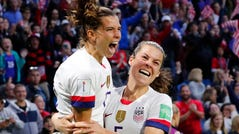 Tobin Heath, left, celebrates with Kelley O'Hara after scoring against Sweden on Thursday.