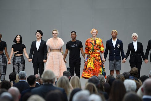 (L-R) Lang Lang, Cara Delevingne, Lil Buck, Robert Carsen, Tilda Swinton, Pharell Williams and Helen Mirren pose on stage during the Karl Lagerfeld Homage at Grand Palais on June 20, 2019 in Paris, France.
