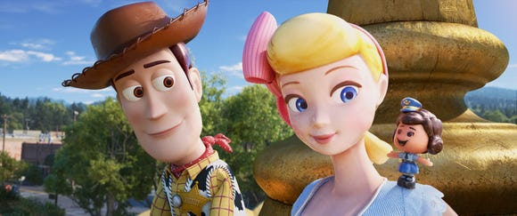 "Woody (left, voiced by Tom Hanks) rekindles his relationship with Bo Peep (Annie Potts) and meets her best friend Giggle McDimples (Ally Maki) in ""Toy Story 4."""
