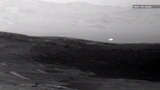 A new image from NASA's Curiosity Rover shows a strange glowing light above the Red Planet's surface.