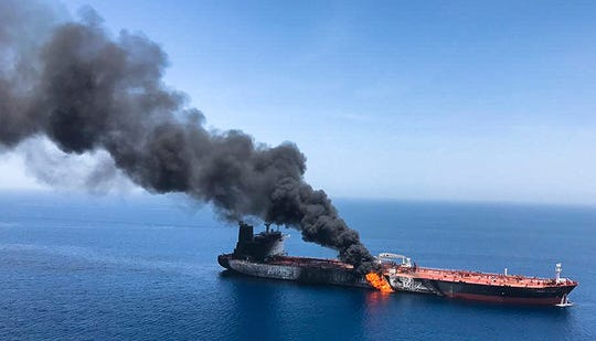 FILE - In this Thursday, June 13, 2019 file photo, an oil tanker is on fire in the sea of Oman. A series of attacks on oil tankers near the Persian Gulf has ratcheted up tensions between the U.S. and Iran -- and raised fears over the safety of one of Asia's most vital energy trade routes, where about a fifth of the world's oil passes through its narrowest at the Strait of Hormuz. The attacks have jolted the shipping industry, with many of operators in the region on high alert. (AP Photo/ISNA, File) ORG XMIT: CAITH501