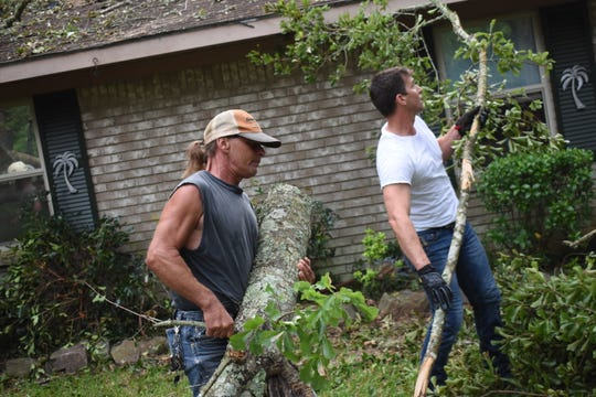 The United Cajun Navy out of Baton Rouge is in town helping Derick and Carmen Cheek and other area storm victims clear away trees and other damage to property. The Cheeks live on Springhill Road in Ball were an F-1 tornado came through the area early Thursday morning causing damage.