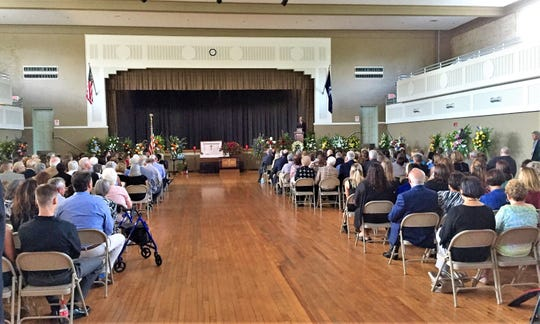 Gov. John Bel Edwards addressed mourners at Haas Auditorium in Bunkie at a memorial service Thursday for doctor, politician and community leader Don Hines.