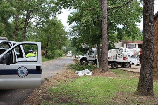 Town of Ball crews and others work on Beeson Road Friday afternoon, repairing damage caused by a tornado that hit around 3 a.m. Thursday.