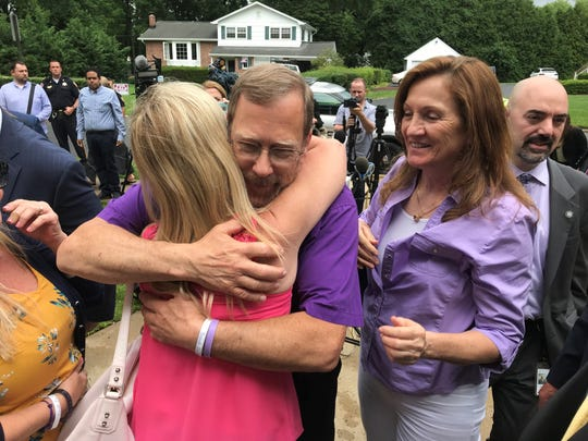 Michael Stern hugs family members outside the Monmouth County Courthouse in Freehold Friday, June 21, 2019, following the sentencing of Liam McAtasney, who was convicted of murdering Stern's daughter Sarah.