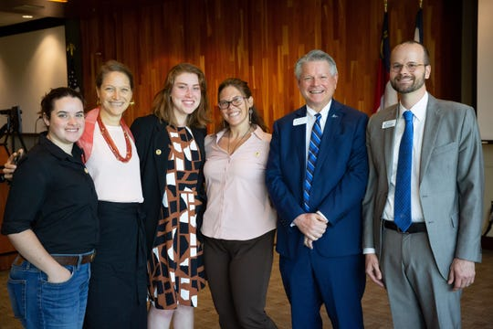 From left, Morgane Marshall, Student Environmental Center co-director; Sonia Marcus, UNC Asheville director of sustainability; Kelsey Hall, UNCA Divest member; Erika Covey, ESG Fund Manager for the SEC; John Pierce, vice chancellor for administration and finance; and Ben Underwood, associate vice chancellor for advancement operations on June 21 after the UNCA Board of Trustees voted to divest a portion of its endowment from fossil fuels.