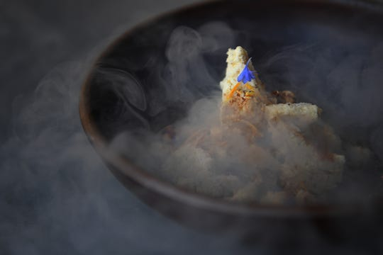 The cheesecake at Cultura has ricotta, black pepper, walnut, and caramelized whey and is served using liquid nitrogen.