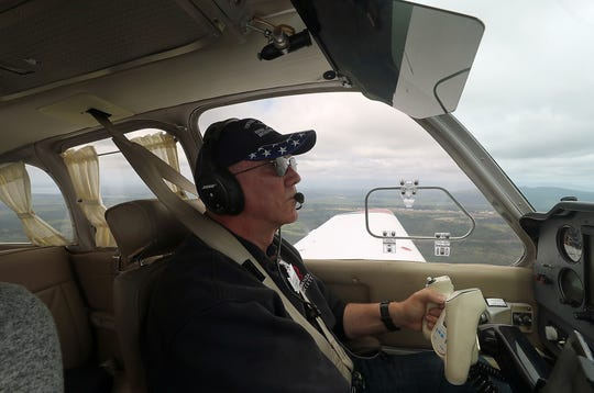 "George Steed, of Silverdale, pilots his Beechcraft Bonanza high above the Kitsap Peninsula as he takes the ""lead"" plane position during a flight for the Northwest Formation Flying Clinic on Friday."