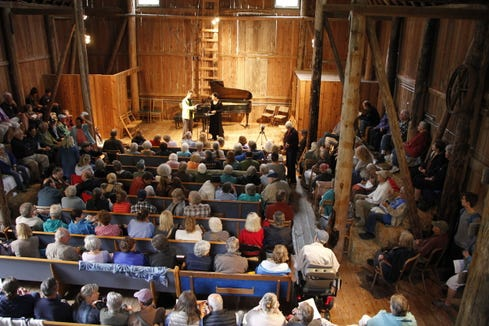 Charles Wetherbee and Korine Fujiwara perform for a packed barn at the 2016 Concerts in the Barn series.