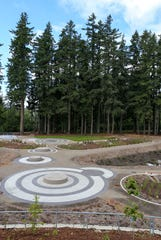 Cement circles house part of the hydraulic system at the new Whispering Firs stormater park but also serve as seating areas to visitors.
