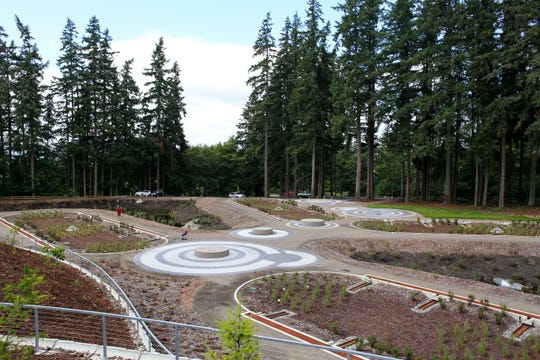Whispering Firs Stormwater Park features four bio-retention cells, two ponds, walkways and picnic tables.