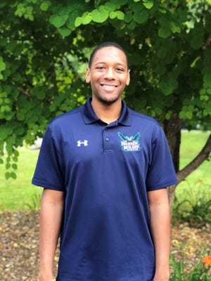 Dominique Boone is the new sports information director for Warren Wilson College and head coach of the Owls men's basketball team.