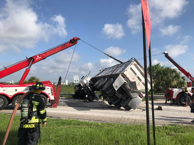 A gravel truck overturned on State Road 528 near U.S. 1 in Cocoa, causing road closures throughout the morning Friday.