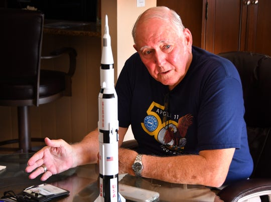 Jim Ogle, former Apollo launch console operator for Apollo 11, in his Merrit Island home with an Apollo/Saturn model next to him, discussing that era.